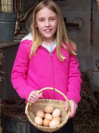 Girl with eggs in basket in doorway