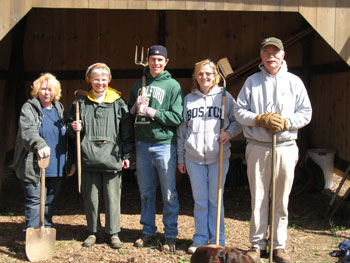 Group of gardeners in front of garden shed