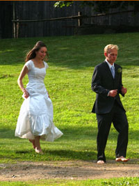 Bride and groom running barefoot